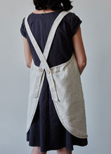 Load image into Gallery viewer, Back of our oat linen apron with coconut buttons