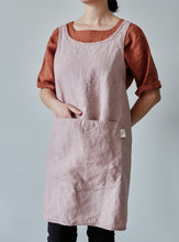 Load image into Gallery viewer, Front of our dusty rose linen apron with a view of the pocket