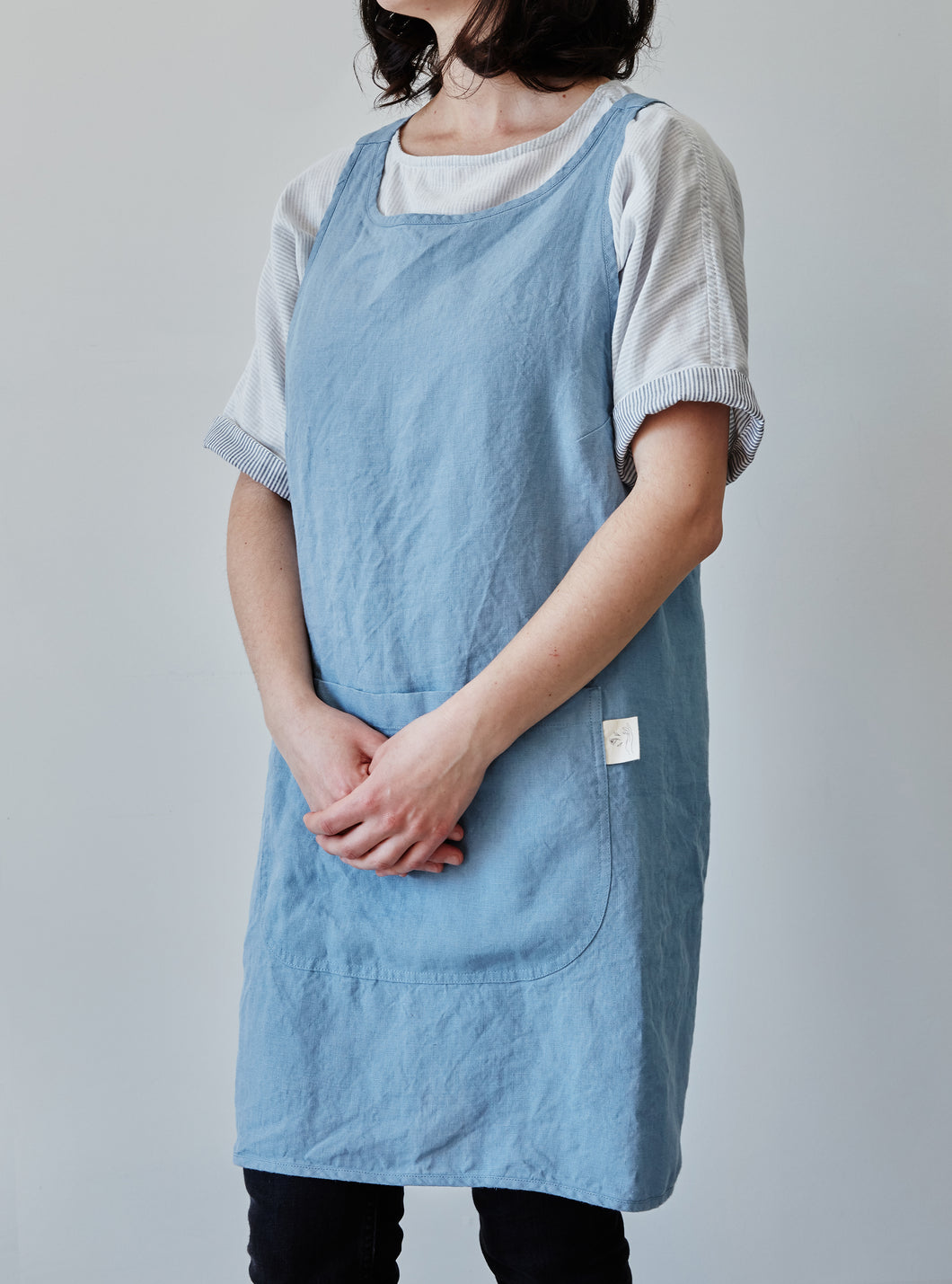 Front of our blue linen apron with large pocket