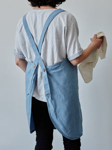 Back of our blue linen apron with coconut buttons