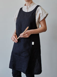 Front of our black linen apron with a view of the pocket