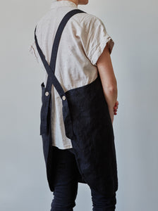 Back of our black linen apron with coconut buttons