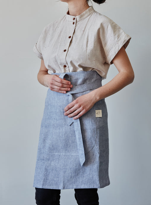 Front of our lavender linen half apron with large pocket