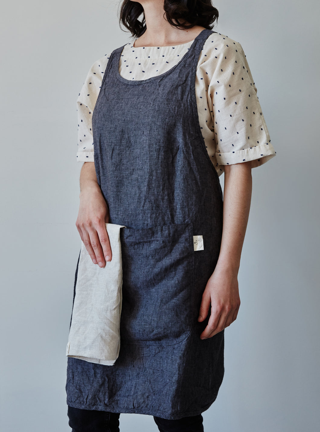 Front of our anthracite linen apron with large pocket