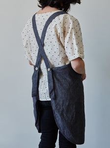 Back of our anthracite linen apron with coconut buttons