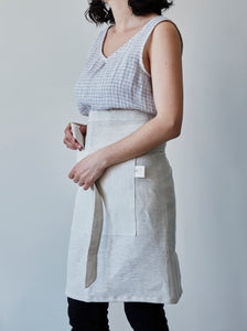 Front of our oat linen half apron with a view of the pocket