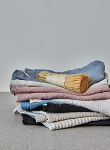 pile of folded linen tea towels