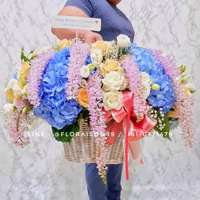 Blue hydrangeas in basket