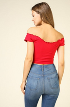 Load image into Gallery viewer, Model is wearing a red off the shoulder crop top with a lettuce trim.
