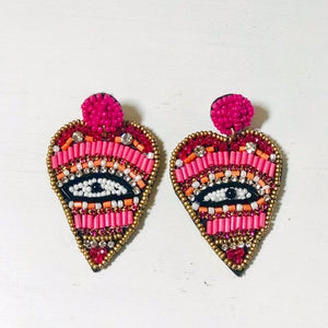 pink beaded evil eye earrings