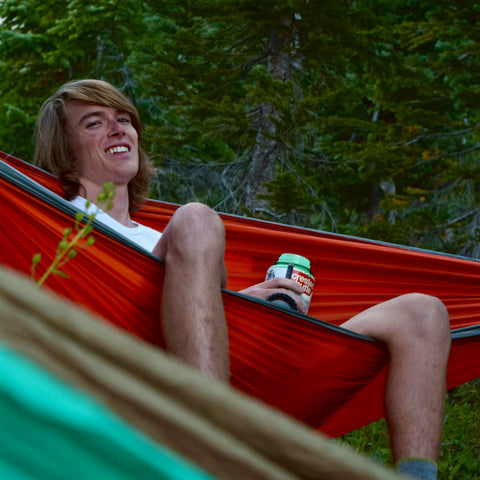 relaxing in red hammock in nature