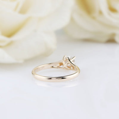 gold round cut moissanite ring