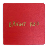 Photograph of a bright red color swatch