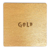 Photograph of a gold color swatch