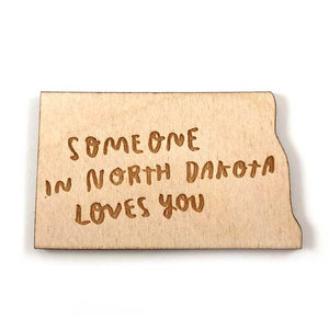 Photograph of Laser-engraved 'Someone in North Dakota Loves You' Magnet
