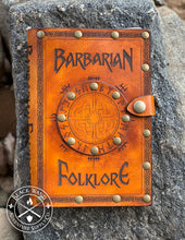 "Load image into Gallery viewer, ""Barbarian Folklore"" medium notebook cover"