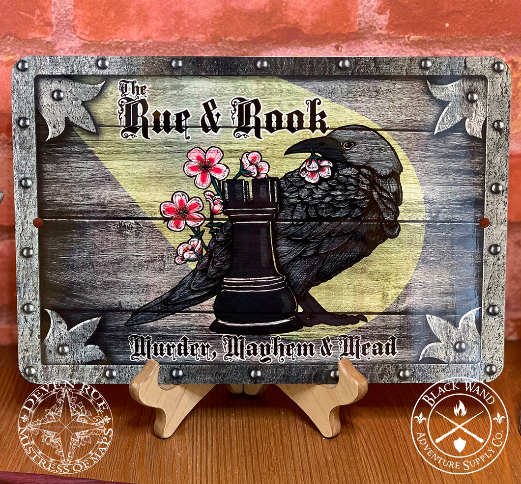 The Rue & Rook metal sign