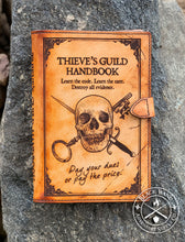 "Load image into Gallery viewer, ""Thieve's Guild Handbook"" Medium Notebook Cover"