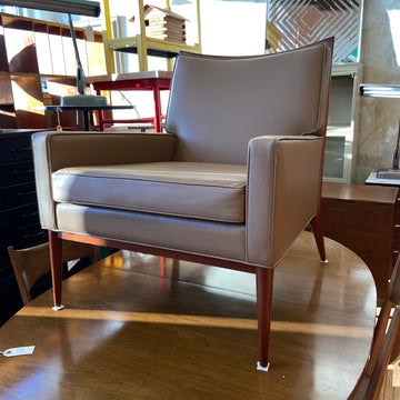 Paul McCobb taupe leather upholstered lounge chair.