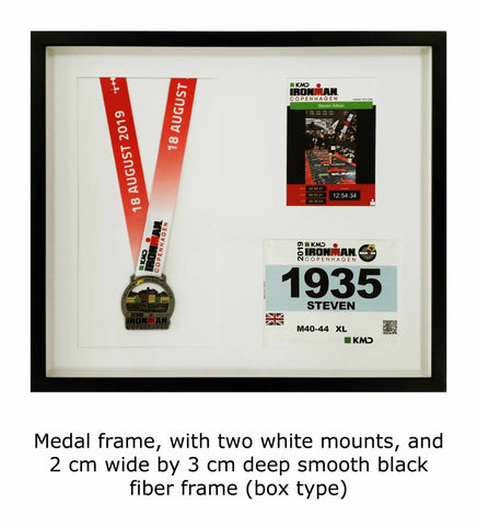 Medal frame with two white mounts and 2 cm wide by 3 cm deep smooth black fiber frame (box type)