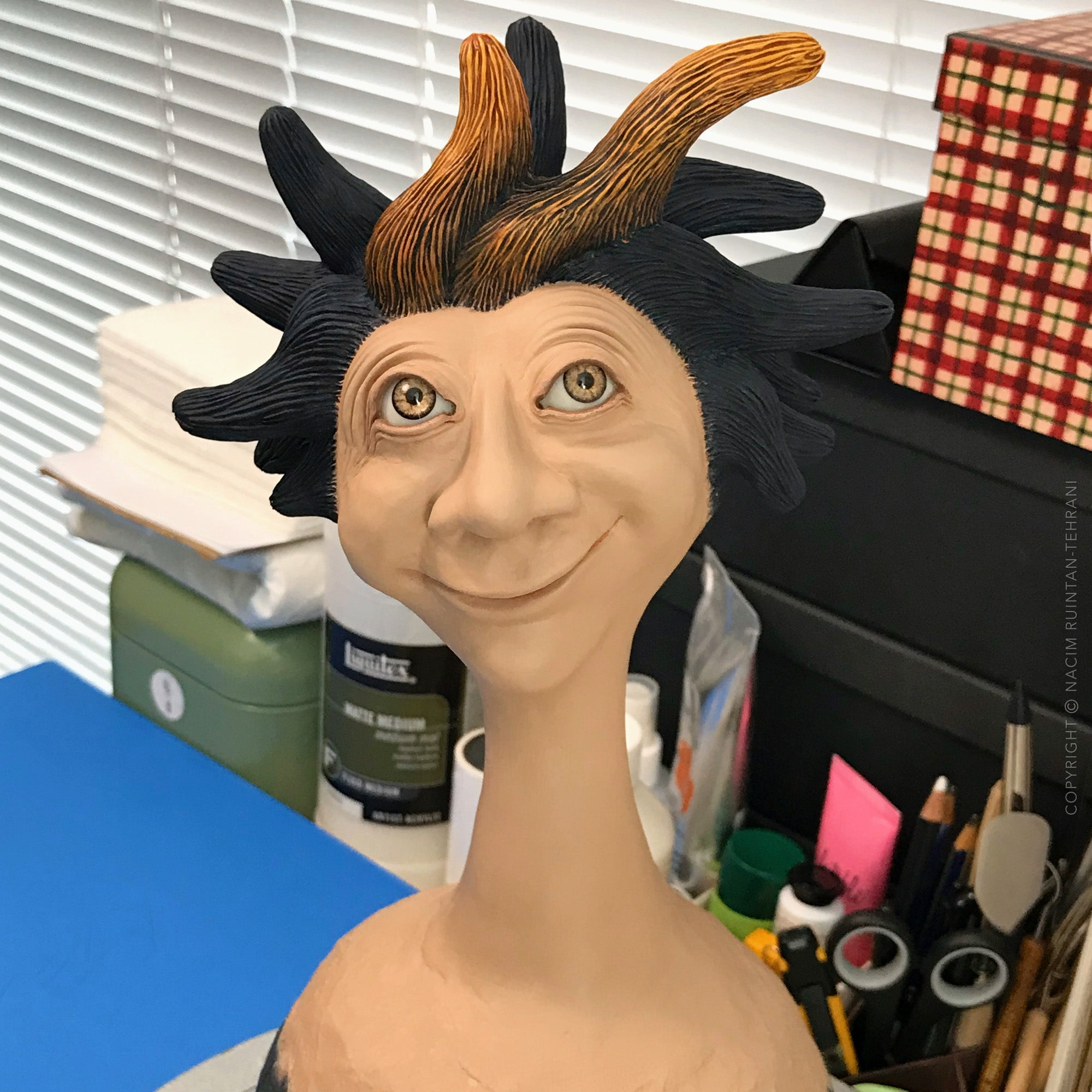 Spiky haired guy with a whimsical smile - a mixed media sculpture artwork in progress by Nacim Ruintan-Tehrani.
