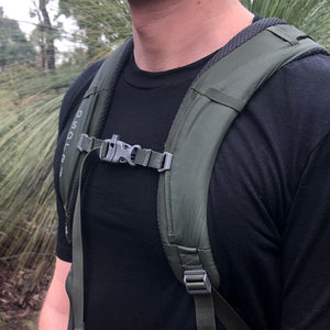 chest shot of an ottie merino wool hiking t-shirt with an osprey backpack.
