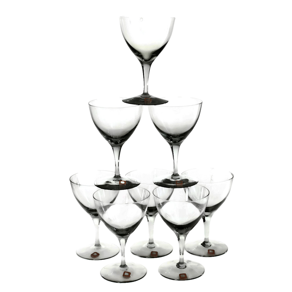 This set of 8 mid century hand blown crystal Dartington cocktail coupes is in pristine condition and still contains the original labels