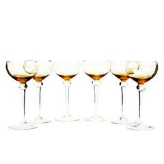 This set of art glass stemware features 6 long stemmed coupes with a beautiful clear ball stem and amber bowl.