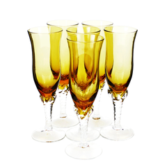 Stunning set of 6 Italian art glass champagne flutes features a fiery amber bowl and clear twisted stem.