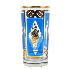 From a set of six royal blue Mid-Century Collins bar glasses with gold rims, flowers and diamond pattern. Made by Dominion Glass Company.