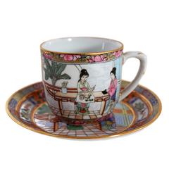 Hand painted china teacup in pinks and blues with gold accents. Features an Asian scene with two women.