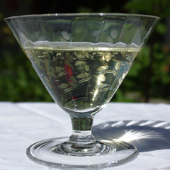 Danish Modern Etched Crystal Champagne Glass with Tulip Shaped Bowl and Short Stem.