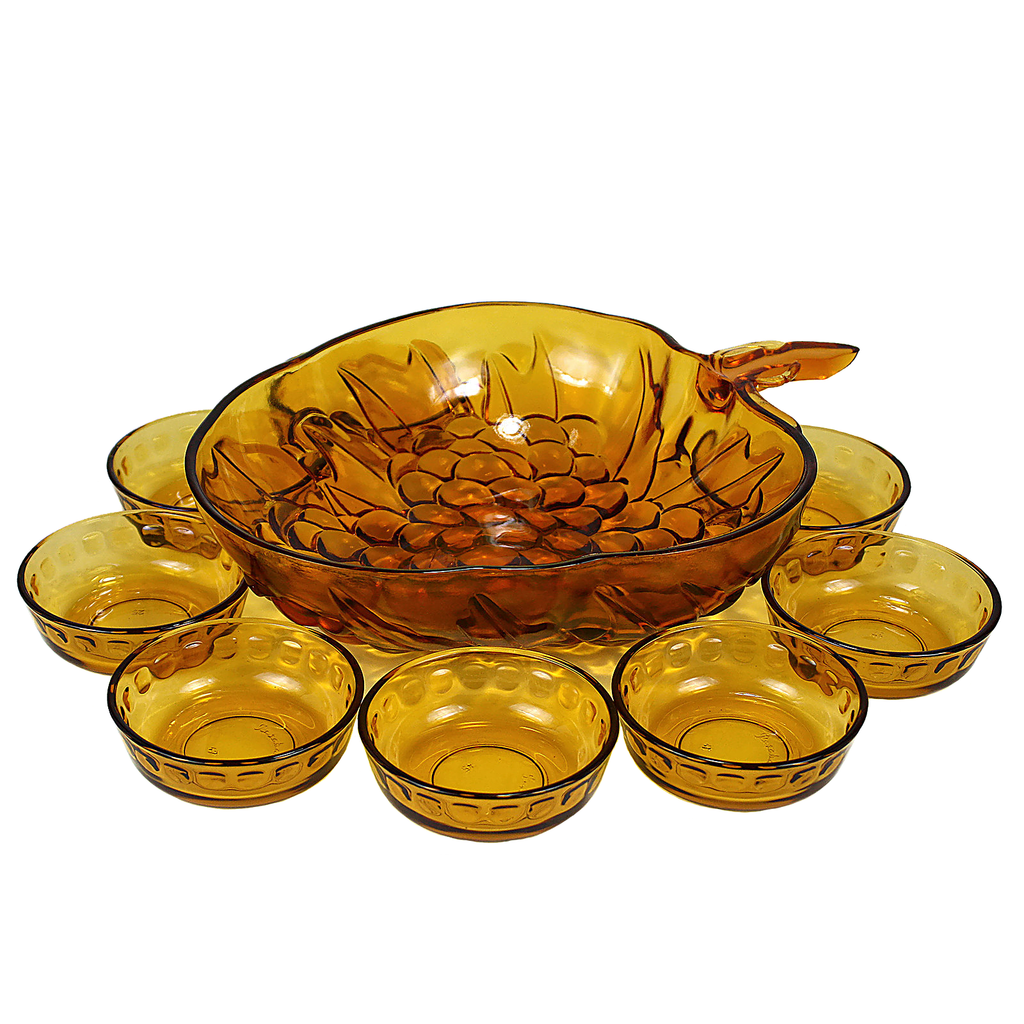 Mid Century serving pieces. 9-piece fruit bowl set in grape pattern. Vintage amber glass.