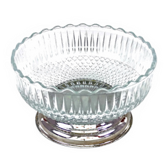 Pedestal serving bowl is a vintage classic featuring an intricate pressed glass pattern, scalloped rim, and eye-catching stepped chrome base.