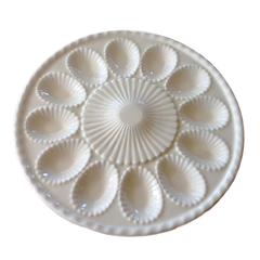 Vintage deviled egg platter by Sylvia Holden. Soft white ceramic with 12 scalloped egg impressions and 22k gold trim.
