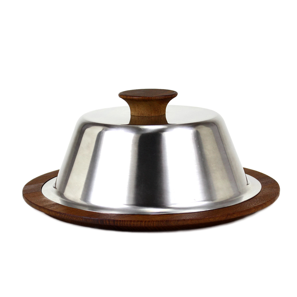 Mid-Century Danish Modern cheese board features round teak base and chrome lid topper.