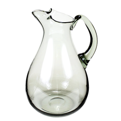 Classic Mid-Century 1960s hand blown glass pitcher beautifully crafted with a pinch spout, elegant curves.