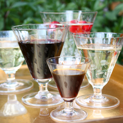 Danish Modern etched crystal stemware in five sizes. Water, red wine, white wine goblets, champagne coupes and liqueur glasses featuring short stems and wide tulip shaped bowls.