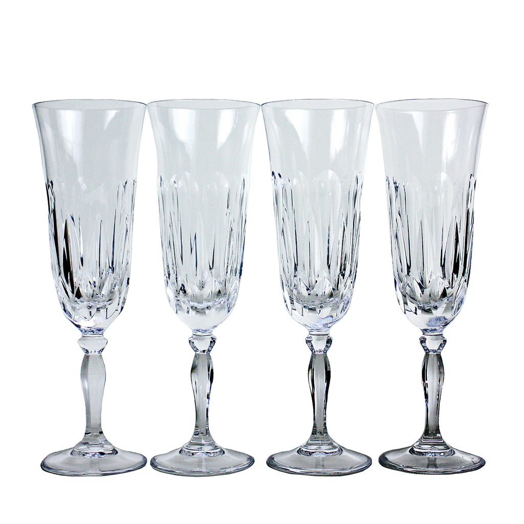 Set of 4 Vintage Crystal Champagne Flutes with Cut Teardrop Pattern.