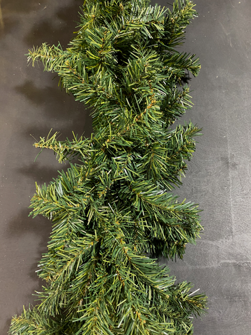 Image of A piece of artificial Christmas garland that looks like a live evergreen garland rope