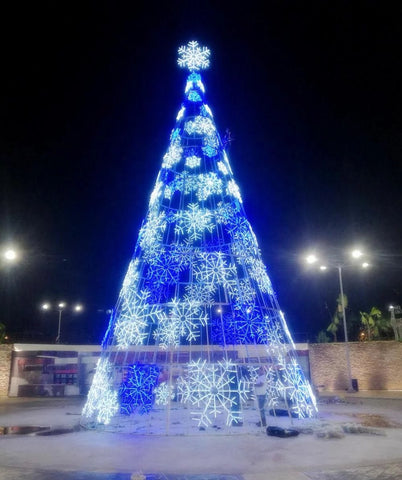 Image of 26 foot christmas tree with white and blue lights and snow flake decorations