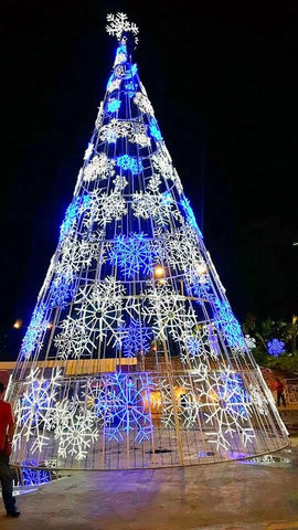 Image of White and blue giant snowflakes on a huge Christmas tree for commercial properties