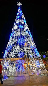 White and blue giant snowflakes on a huge Christmas tree for commercial properties