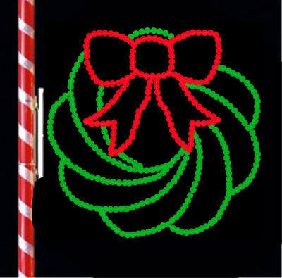 Green wreath with red ribbon in lights to hang from poles and street lights