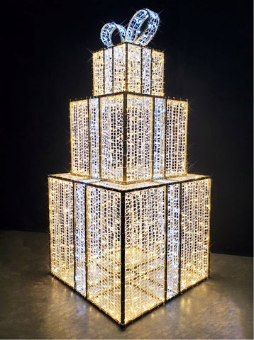 Oversized Majestic Christmas Presents pictured standing on the groud gold with white lights