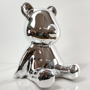 A shiny seated bear
