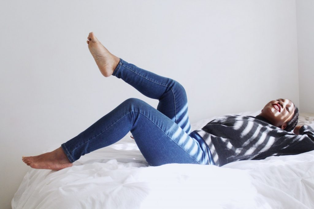 woman kicked back relaxing in bed