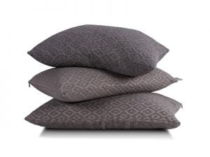 stacked gray pillows