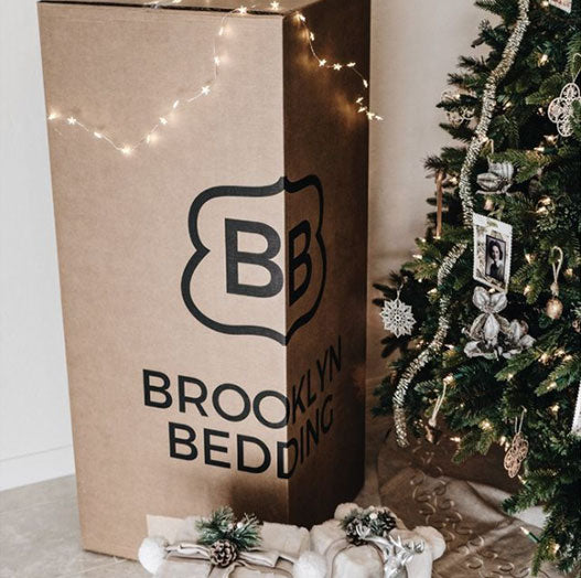 bed in box next to christmas tree