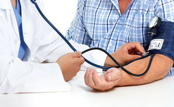 checking a man's blood pressure
